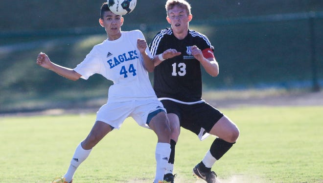 Eastside's Erick Gonzalez (44), who scored the game's only goal, battles for possession during the Eagles' 1-0 win over Walhalla in the second round of the Class AAA playoffs Thursday night at John Carlisle Stadium.