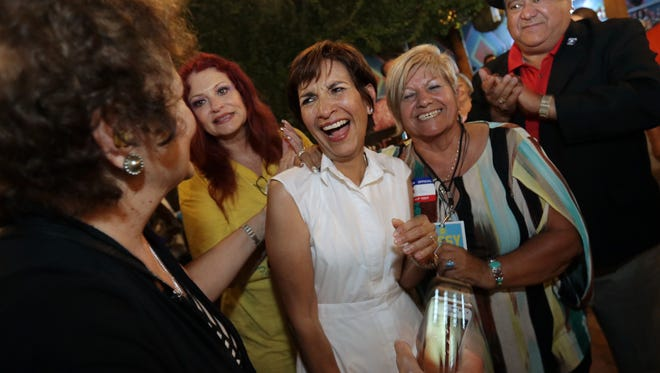 """District 8 city Rep.-elect Cecilia """"Cissy"""" Lizarraga, center, celebrates her runoff victory Saturday night at Hope and Anchor patio bar, 4012 N. Mesa St. The special election was held to replace the seat left vacant by Cortney Niland's resignation."""