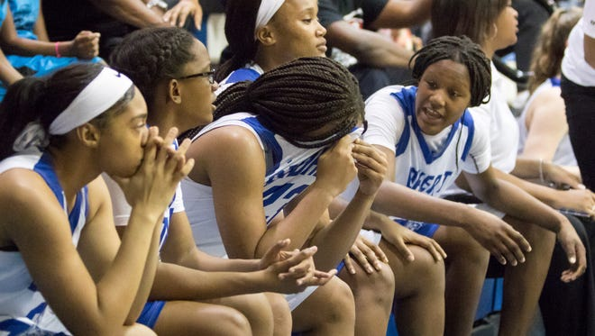 Jaila Roberts (23) buries her head in her jersey as they are about to lose the Region 1-7A quarterfinal girls basketball game between Washington and  Fort Walton Beach at Booker T. Washington High School in Pensacola on Thursday, February 15, 2018.