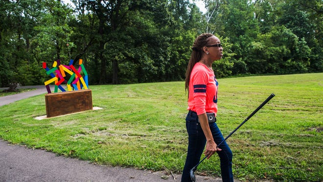 "August 23, 2017 - Debra Lovelace, president of the Denver Park Neighborhood Association, walks with a golf club during a visit to Denver Park, located in Frayser. At one point, the Memphis Police Department's Community Outeach Program (COP) was heavily concentrated in the Frayser community but has since moved to other areas in Memphis. ""Along with the COP program, the Denver Park Neighborhood Association and the residents of this area, and all of the other agencies or organizations in Frayser ... we all got together to go to City Hall and asked them to renovate this park for us. We just actually worked real hard to get the park and when we got it, it was so beautiful. It was like a dream. And then all of a sudden it just like turned back into a nightmare,"" Lovelace said. ""It's sad really. They (the city) moved our COP program; they're not able to work with us like they did. I guess we're not important other here. I don't know, we're trying and we want better."""