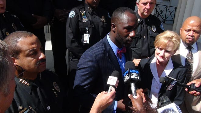 Mayor Tony Yarber (center) speaks at a press conference at City Hall. Jackson Police Chief Lee Vance 9left) and Mississippi Agriculture Commissioner Cindy Hyde-Smith (right) listen.