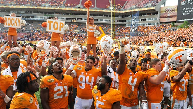The Tennessee Volunteers football team celebrates its 45-6 victory over Northwestern in the 2016 Outback Bowl on  Friday Jan. 1, 2016, in Tampa, Florida.