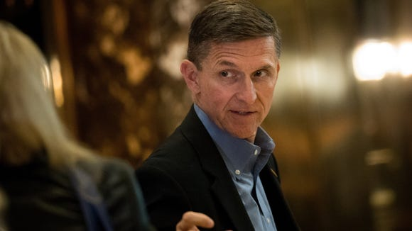 Mike Flynn walks through the lobby at Trump Tower on