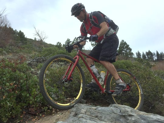 Jeff Moser, 45, of Carson City, rides his mountain