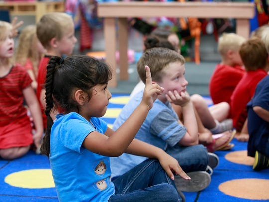 Daniella Alba answers a question in Phyllis Cox's kindergarten class on Wednesday at Lydia Rippey Elementary School in Aztec.