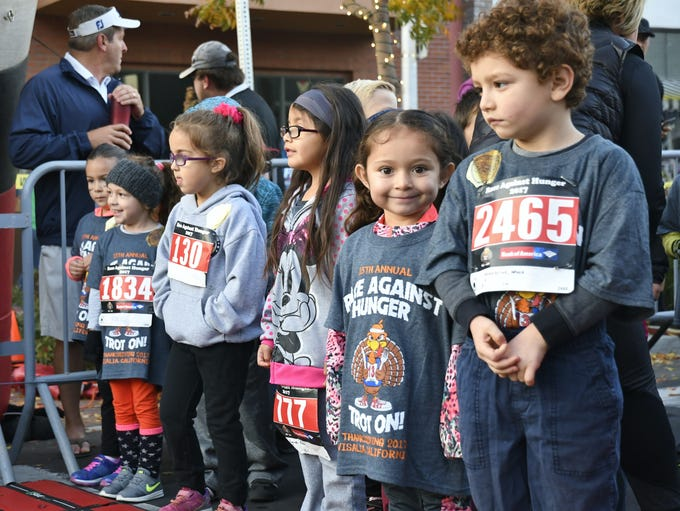 Thousands braved the chilly Thanksgiving morning to