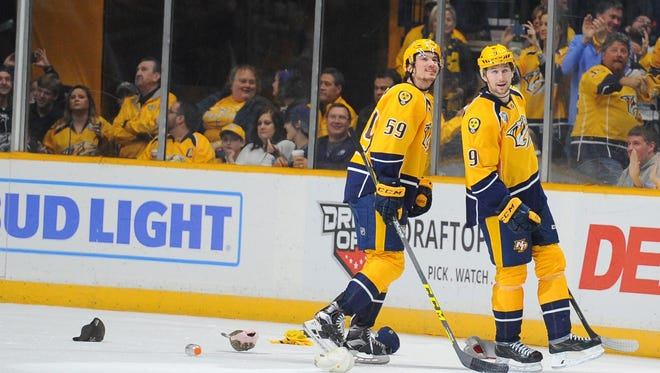 Predators left wing Filip Forsberg (9) celebrates with defenseman Roman Josi (59) after completing a hat trick in the second period Saturday.