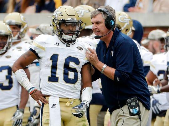 Georgia Tech coach Paul Johnson, right, talks with