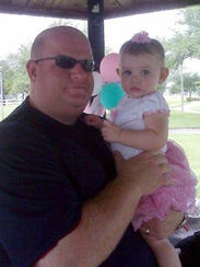 Aaron Feis with an unidentified girl.