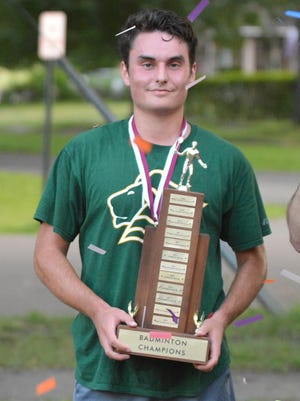 Andrew Buck holds the 2020 Martuscello Annual Badminton Tournament trophy after his victory Tuesday.