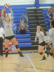 Cooper's Pearce Bjorlie (3) sets the ball during the Lady Cougars' match against Wichita Falls Hirschi. Cooper swept Hirschi 25-20, 25-16, 25-14 in the nondistrict match Tuesday, Sept. 19, 2017 at Cougar Gym.