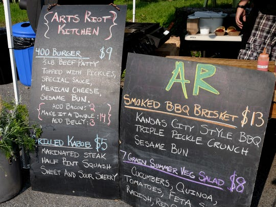 The menu board for the ArtsRiot concession at the Truck Stop on Friday, July  3, 2015, on Pine Street in Burlington.