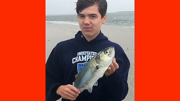 Tommy L. with a bluefish he caught on the north end of Brigantine.