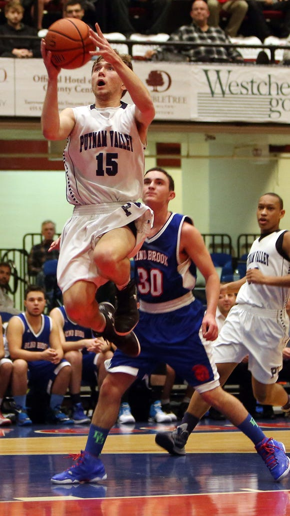 Putnam Valley's Anders Spittal (15) drives to the basket in front of Blind Brook's Jake Digiansante (30) during the boys Class B semifinal at the Westchester County Center in White Plains Feb. 24, 2016. Putnam Valley won the game 48-39.