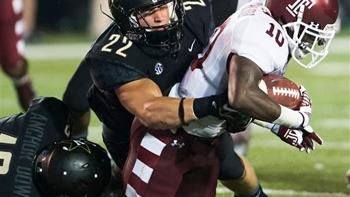 Temple wide receiver Khalif Herbin (10) is tackled by Vanderbilt outside linebacker Casey Hughes (22) during the second quarter of an NCAA college football game Thursday, Aug. 28, 2014, in Nashville, Tenn. (AP Photo/Brian Powers)