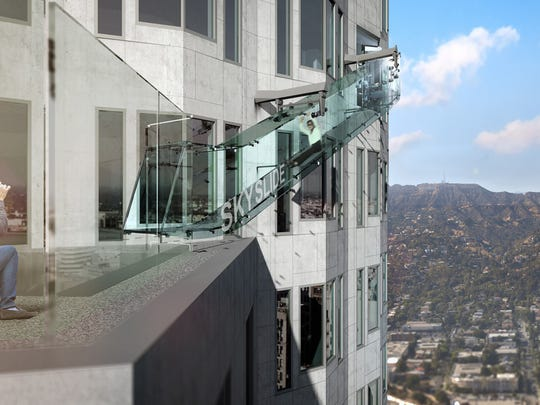 A rendering of Skyslide, a glass chute scheduled to debut at LA's U.S. Bank Tower in June. (Photo courtesy OUE Skyspace/TNS)