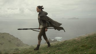 Rey (Daisy Ridley) is on a mission to convince Luke Skywalker to fight the good fight once more in 'Star Wars: The Last Jedi.'