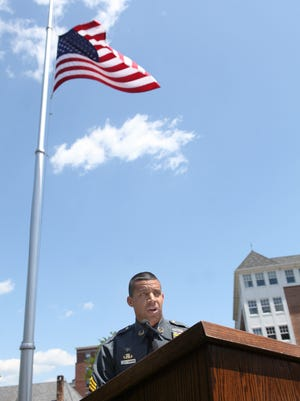 Sgt. Aaron Tomasini, a Morris County sheriff's officer, during his keynote address at the Memorial Day ceremony on the front lawn of the Morris County courthouse.