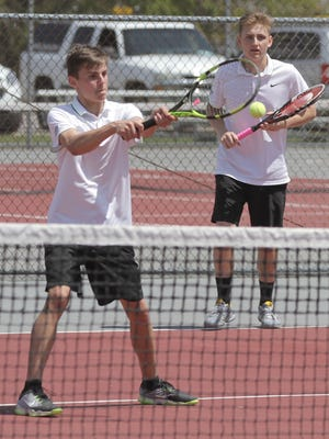 Cousins Blake Webster (foreground) and Luke Webster of Lexington took their first round match in the state tennis tournament to three sets before falling.