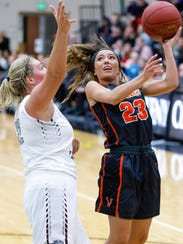Ankeny Centennial High School's Chloe Olsen (22) guards
