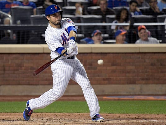New York Mets' Travis d'Arnaud hits a three-run home run during the fifth inning of a baseball game against the Washington Nationals on Friday, Sept. 22, 2017, in New York. (AP Photo/Bill Kostroun)