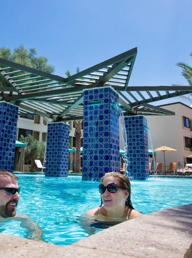 Brian Franks and his wife, Lynsey, take a dip in the pool at The Scottsdale Resort at McCormick Ranch on April 29, 2016.