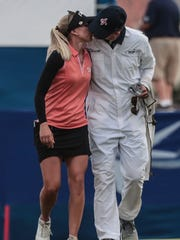 Pernilla Lindberg kisses her fiancee and caddie Daniel Taylor after finish 3rd round of the ANA Inspiration with the lead on Saturday, March 31, 2018 at Mission Hills Country Club in Rancho Mirage.