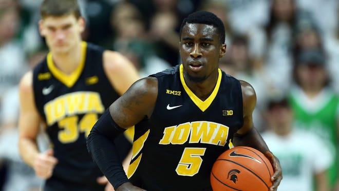 Iowa Hawkeyes guard Anthony Clemmons (5) brings the ball up court during the first half against the No. 4 Michigan State Spartans.