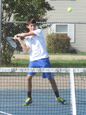 Mountain Home's Alex Arp returns a shot against Marion on Tuesday at Mountain Home Athletic Club.