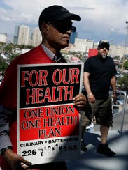 Culinary Union members file into a university arena