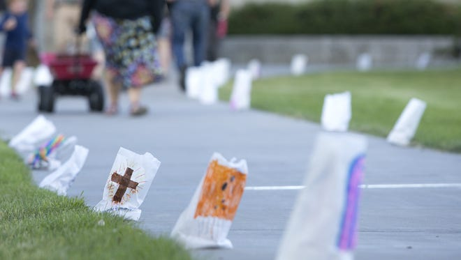 Over 1,000 paper bags decorate the Rivers Edge Trail for the Luminaria Walk.