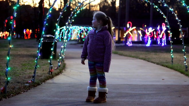 London Dangerfield, 7, takes in the beauty of Costner's Christmas Light Extravaganza at Patriots Park in Kings Mountain on Thursday.