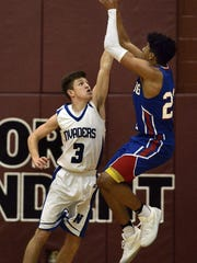 Spring Grove's Eli Brooks shoots a jumper over West Scranton's Blake Carlton on Friday night.