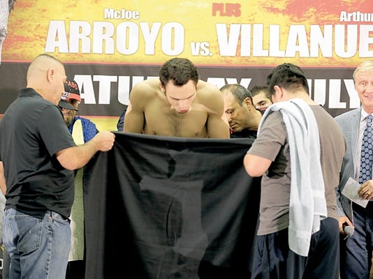 Julio Cesar Chavez Jr. keeps his eye on the scale from the second he gets up on it during Friday's weigh-ins. Chavez came in at 170.8 pounds, slightly overweight. The fight will go on today, but Chavez had to pay opponent Marcos Reyes an undetermined amount of money for not making the stipulated weight for tonight's 10-round Showtime main event at the Don Haskins Center.