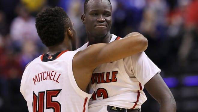 U of L's Deng Adel (22) and Donovan Mitchell (45) embraced after their 73-69 loss to Michigan during the NCAA tournament at the Bankers Life Fieldhouse in Indianapolis.Mar. 19, 2017