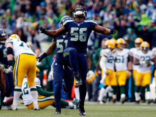 Seahawks pass rusher Cliff Avril reacts making a sack during the the 2015 NFC Championship game against the Green Bay Packers.