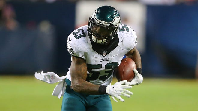 Philadelphia Eagles linebacker Nigel Bradham (53) carries after making an interception during the second half against the Chicago Bears at Soldier Field.