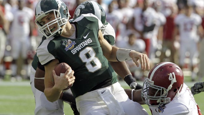 Michigan State quarterback Kirk Cousins is sacked by Alabama linebacker Courtney Upshaw during the Capital One Bowl on New Year's Day 2011. MSU lost that game 49-7. Today is a measuring stick to see how far the Spartans have come.