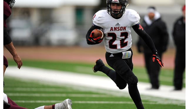 Anson wide receiver Trell Thomson (22) runs the ball during the first quarter of Anson's 21-18 loss in the Class 2A Div. I state quarterfinal playoff on Saturday, Dec. 3, 2016, at Tiger Stadium in Snyder.