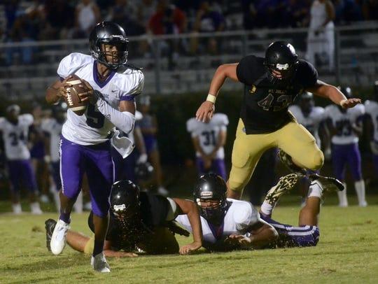 Cane Ridge quarterback D.J. Thorpe eludes the rush