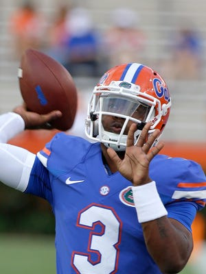 In this Sept. 13, 2014, file photo, Florida freshman quarterback Treon Harris  warms up prior to an NCAA college football game against Kentucky in Gainesville, Fla. Harris has been suspended while he is being investigated for sexual assault. The school says Harris is accused of sexually assaulting a female student early Sunday, Oct. 5, hours after Harris helped Florida rally to beat Tennessee 10-9 in Knoxville, in a residence hall on campus in Gainesville, Fla.