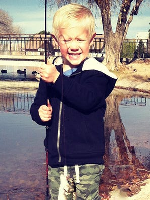 Tyson Egnaczak, 3, of Las Cruces, caught this rainbow trout Dec. 28, while fishing at Alumni Pond on the campus of New Mexico State University. His first fish he's ever caught was done using a worm.