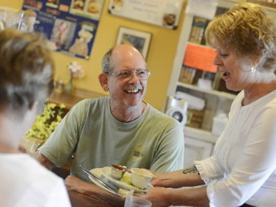 Ray Hasener of Shrewsbury Township chats with waitress Terri Johnston as she clears his plate at Nikolas' Cafe in Shrewsbury Tuesday, July 2, 2013. Hasener and his wife Sandy, left, are regulars are the cafe.
