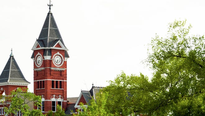 The clock tower of Auburn University's Samford Hall is pictured. Faculty and staff have concerns as the school prepares to reopen for on-campus classes.