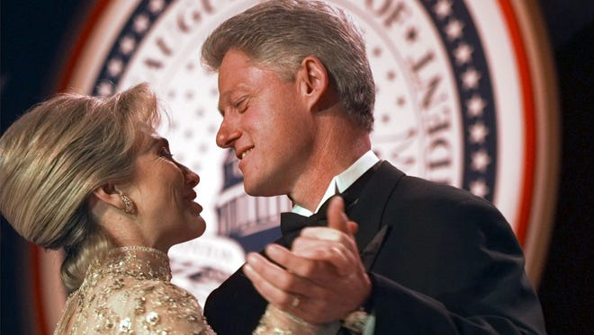 In this file photo, former President Bill Clinton dances with his wife, Hillary, at the Veterans Ball Monday, Jan. 20, 1997, in Washington.