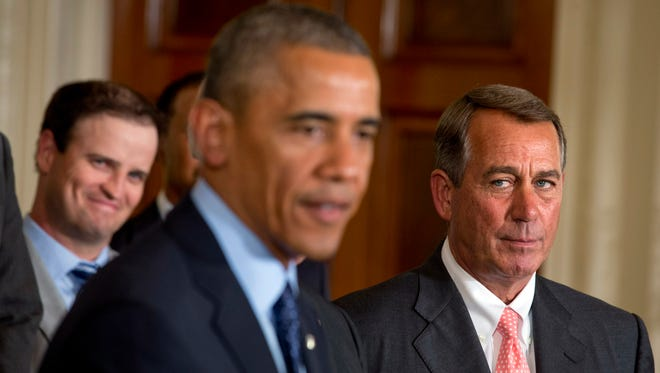 House Speaker John Boehner keeps a watchful eye on President Obama at the White House last month.