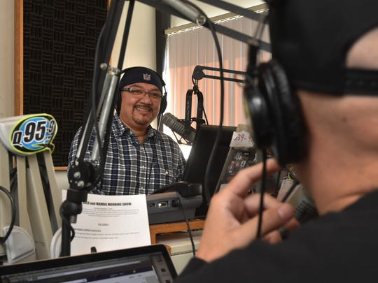 "Jaime ""Rico"" Rangel laughs during a recent ""Rico and Mambo Morning Show."" Rico and Mambo will celebrate 20 years of working together on the air this month."