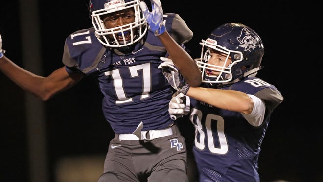 Bay Port receiver Cordell Tinch, left, celebrates a touchdown with Jordan Nolle against Green Bay Notre Dame on Sept. 30. The Pirates went 9-0 to win the Fox River Classic Conference this year.