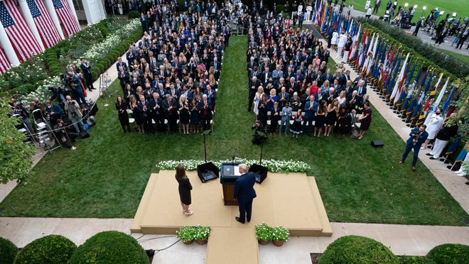 President Donald Trump, center, stands with Judge Amy Coney Barrett as they arrive for a news conference to announce Barrett as his nominee to the Supreme Court, in the Rose Garden at the White House, Saturday, Sept. 26, 2020, in Washington.