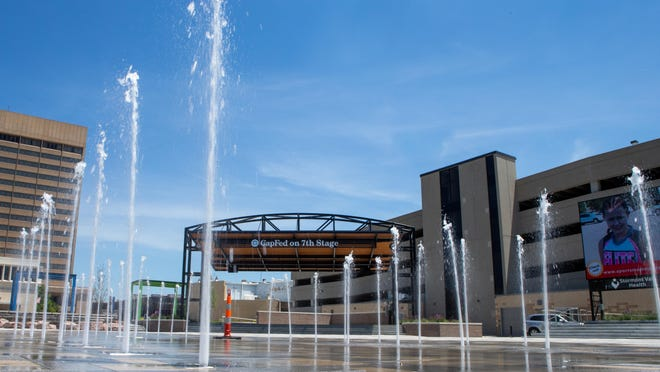 Jets of water spring up from the middle of the Evergy Plaza on Thursday afternoon as crews work on testing the fountain features. On the north end is a waterfall feature that was also being tested.
